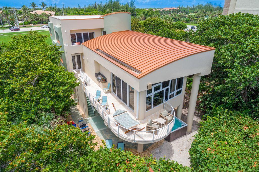 Wrap around oceanfront balcony at Oceania beach house in Jensen Beach Florida