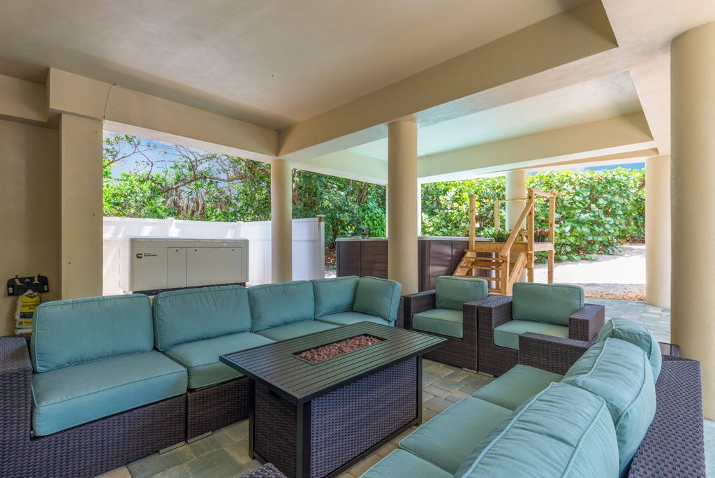 Covered conversation pit with teal upholstered cushions