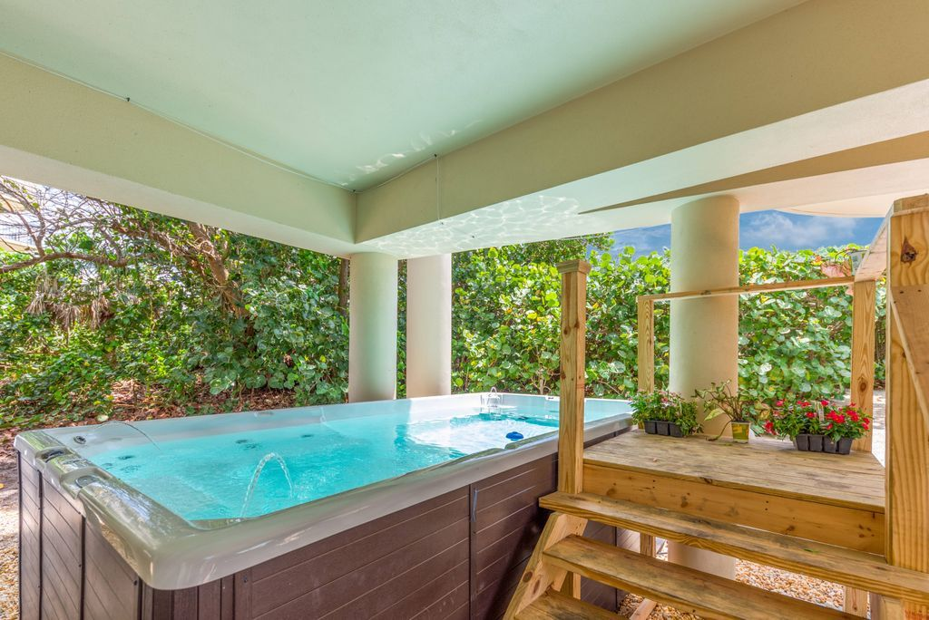 Partially covered swim spa plunge pool and surrounding deck