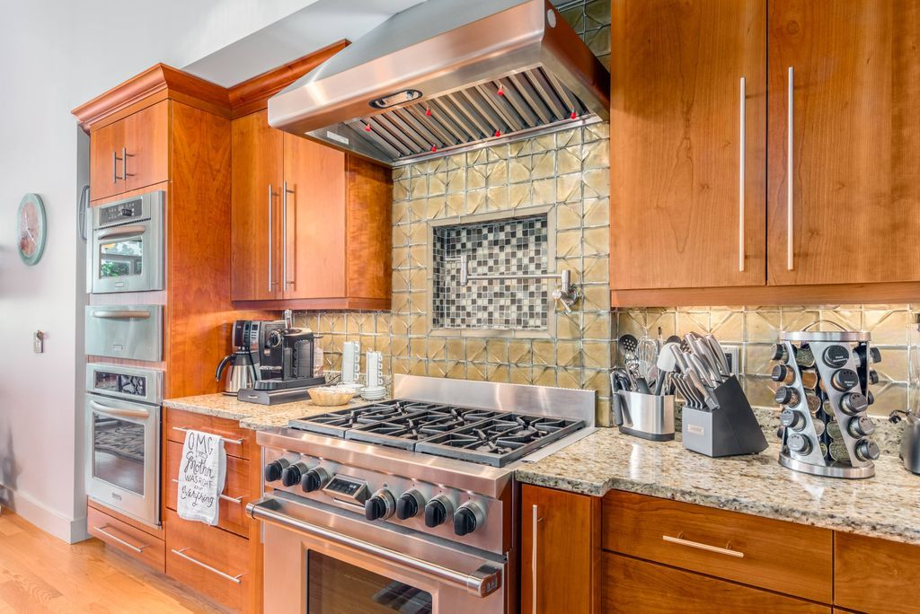 Stainless steel gas range and hood