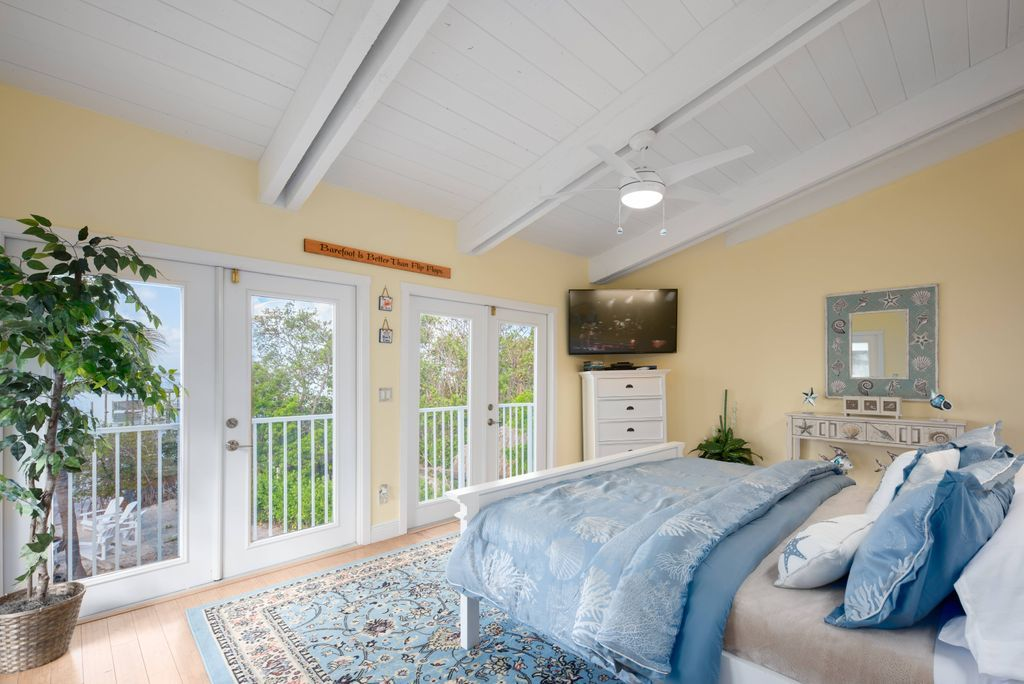 Master bedroom at Aquarius with French style doors leading to the balcony