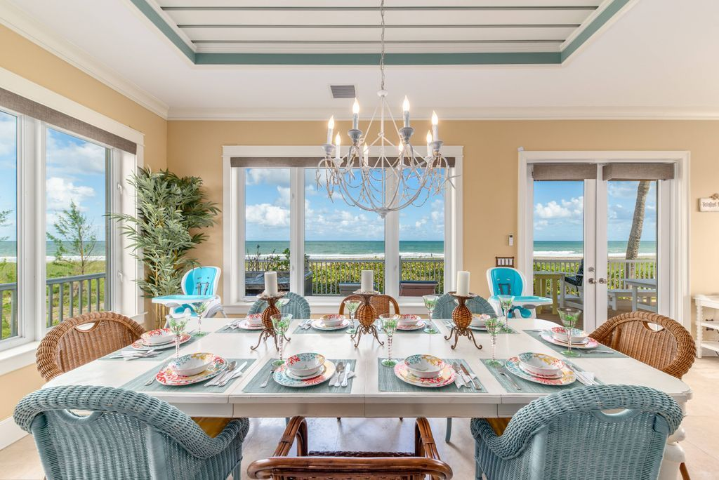 Beachfront dining room with candlestick chandelier