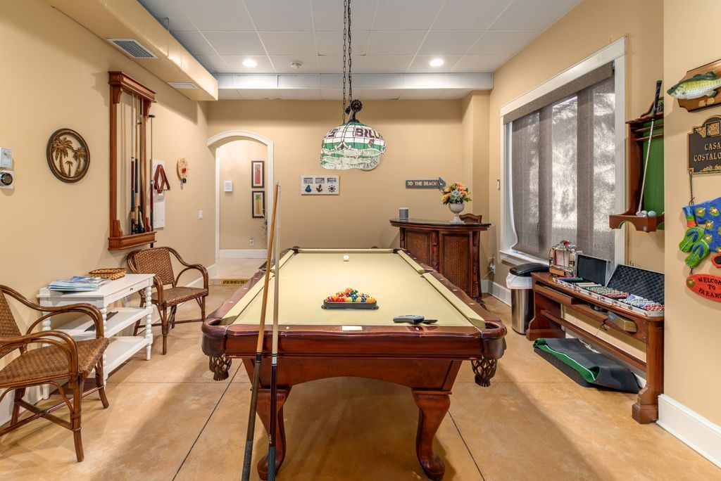 Wooden billiards table in game room at Bella Vista