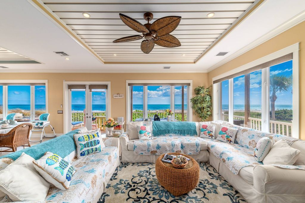 Beachfront living room with plantation ceiling fan at Bella Vista