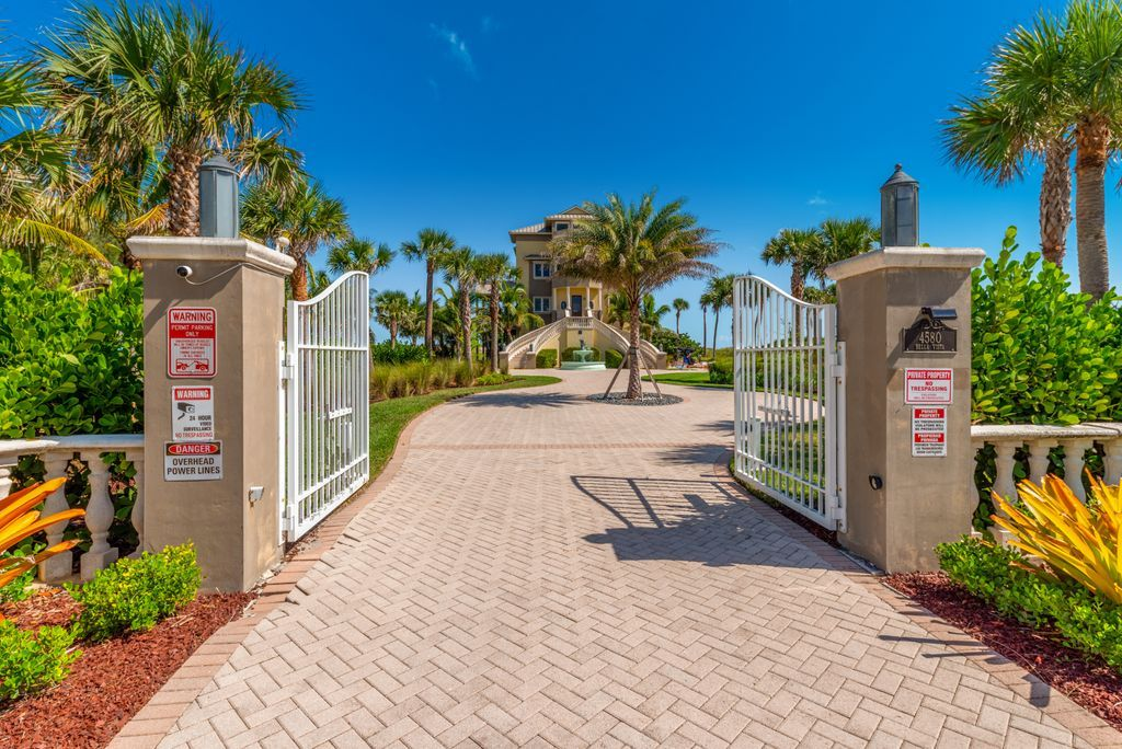Open gated entry doors to the Bella Vista beach house in Ft. Pierce, FL